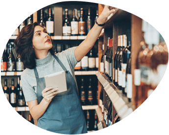 Woman Purchasing a Bottle of Wine