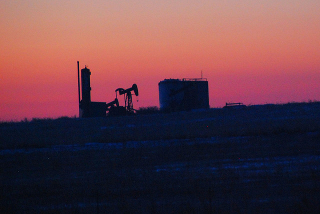 Kansas: how to tax oil well products, services.