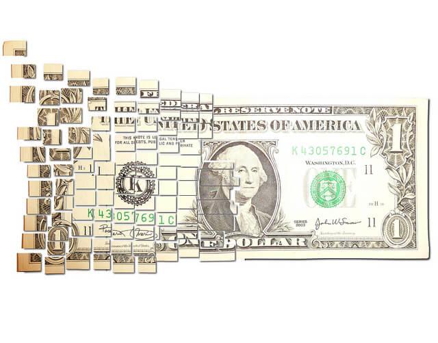 dollar bill in pieces